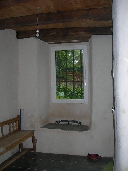 Percement fenêtre, mur chaux